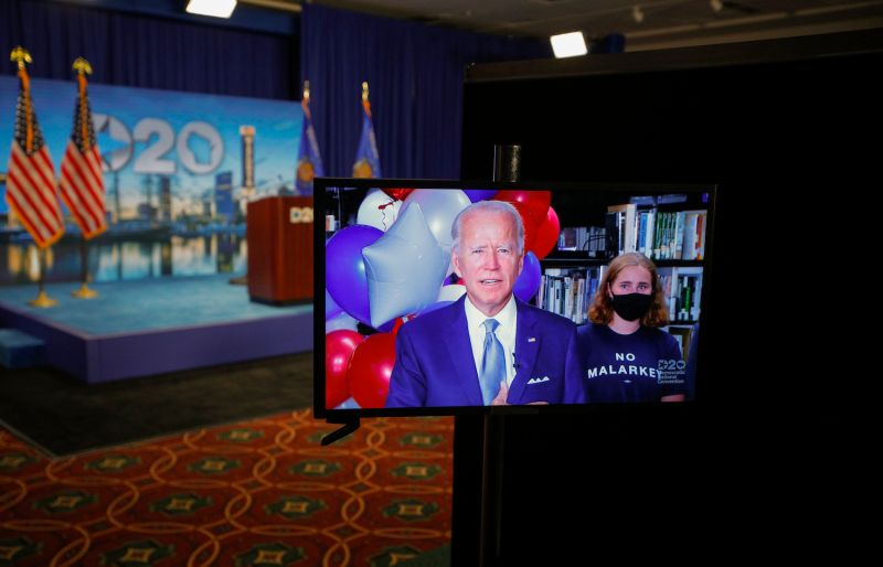 Former U.S. Vice President Joe Biden reacts in a video feed from Delaware after winning the votes to become the Democratic Party's nominee for president in Milwaukee, Wisconsin, on Aug. 18.