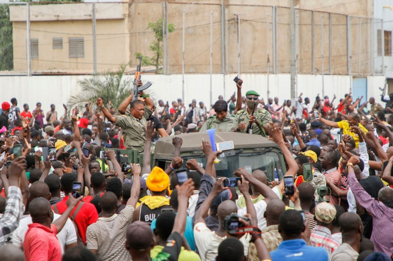 Crowds cheer as soldiers parade in Bamako, Mali, on Aug. 18.