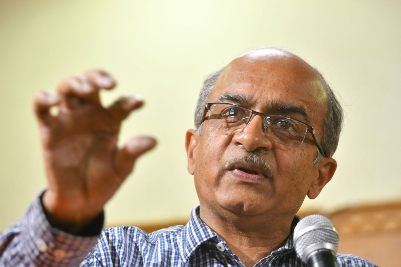 Indian Supreme Court lawyer and anti-corruption activist Prashant Bhushan gestures as he speaks during a public talk.