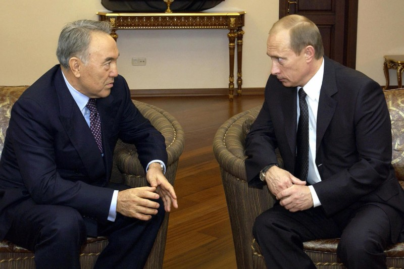 Russian President Vladimir Putin talks to his Kazakh counterpart Nursultan Nazarbayev in Baku, Azerbaijan in December 2003.