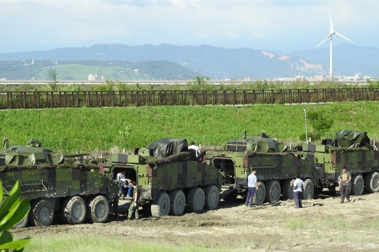 Civilian contractor mechanics conduct checks and repairs on the Taiwanese army's Clouded Leopard infantry fighting vehicles during the Han Kuang military exercise.
