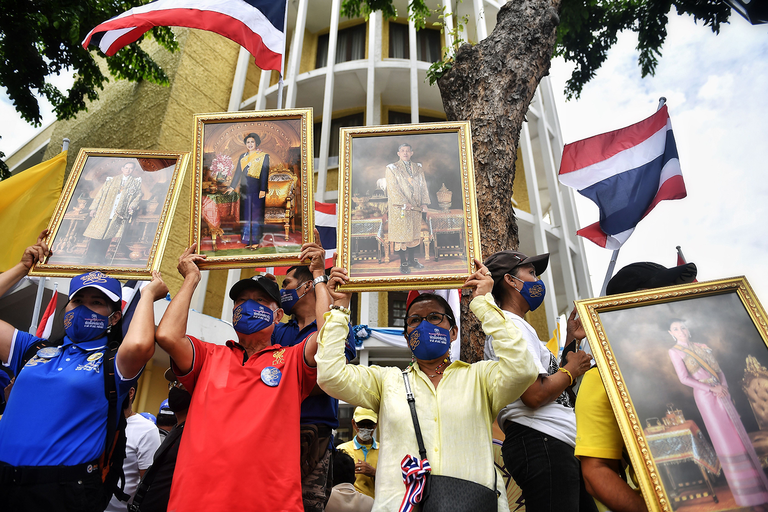Pro-royalist protesters hold pictures of members of Thailand's royal family in Bangkok on Aug. 16 ahead of anti-government protests in the Thai capital.