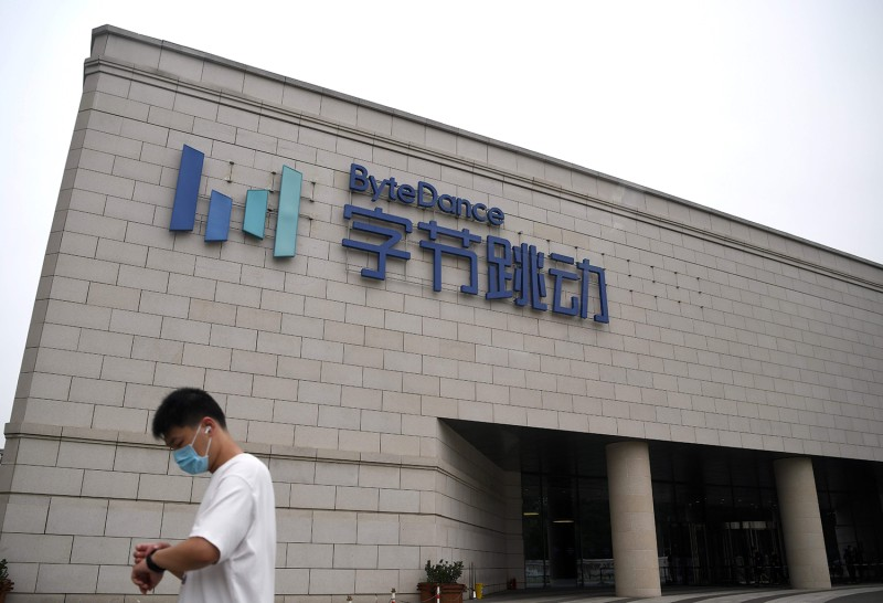 An employee walks outside the headquarters of ByteDance, the firm that owns the video-sharing app TikTok, in Beijing on Aug. 5.