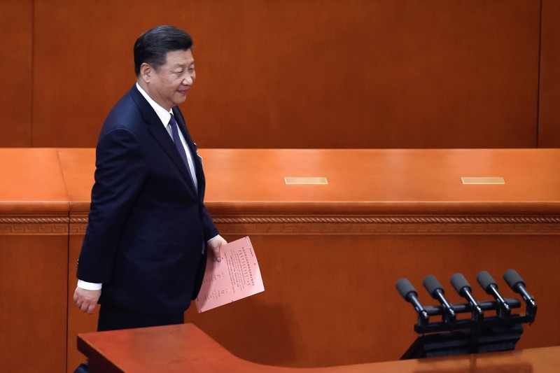 Chinese President Xi Jinping prepares to vote during the third plenary session of the first session of the 13th National People's Congress at the Great Hall of the People in Beijing on March 11, 2018.