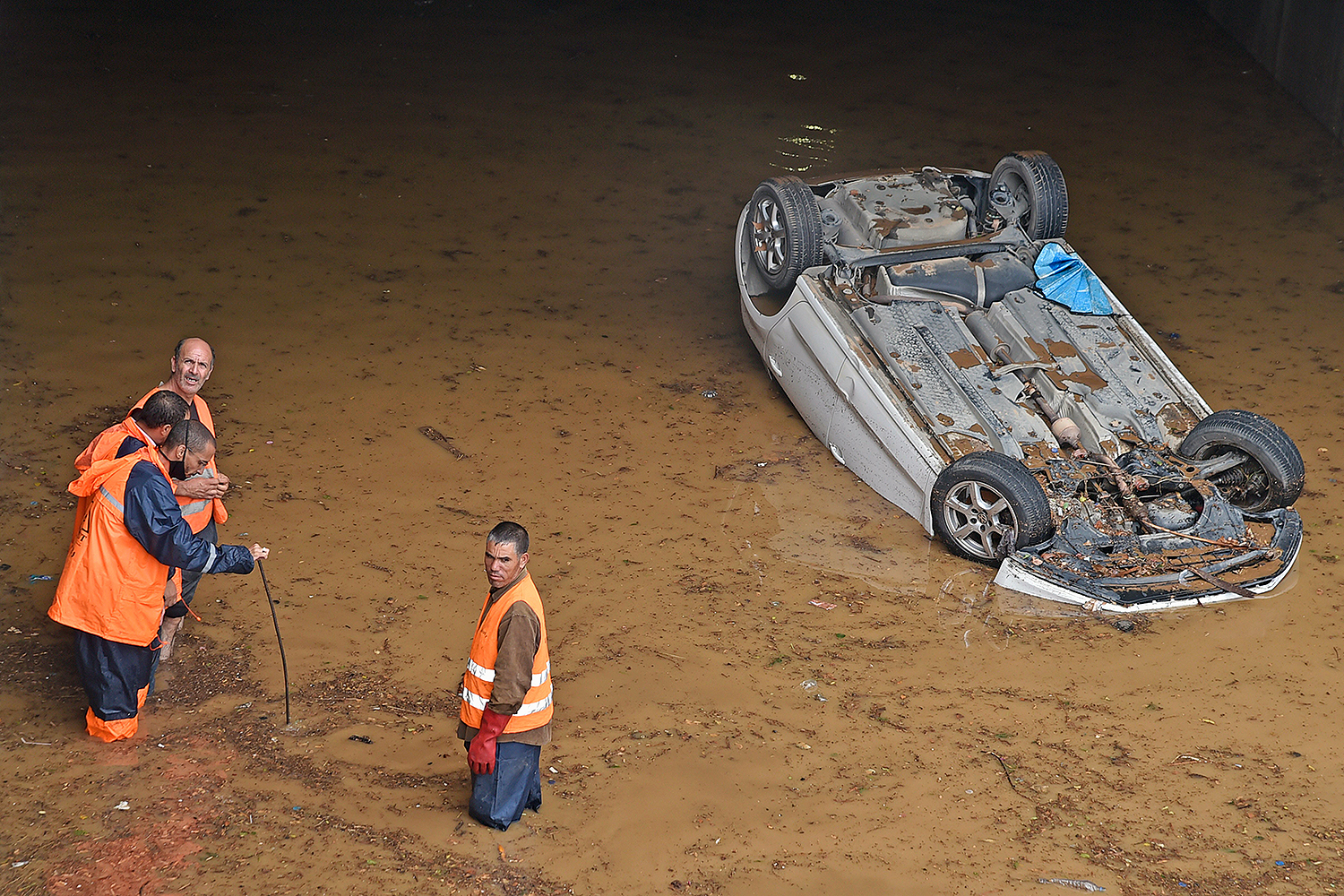 A partially submerged car is seen on a flooded street in the Algerian capital Algiers on Sept. 8. RYAD KRAMDI/AFP via Getty Images