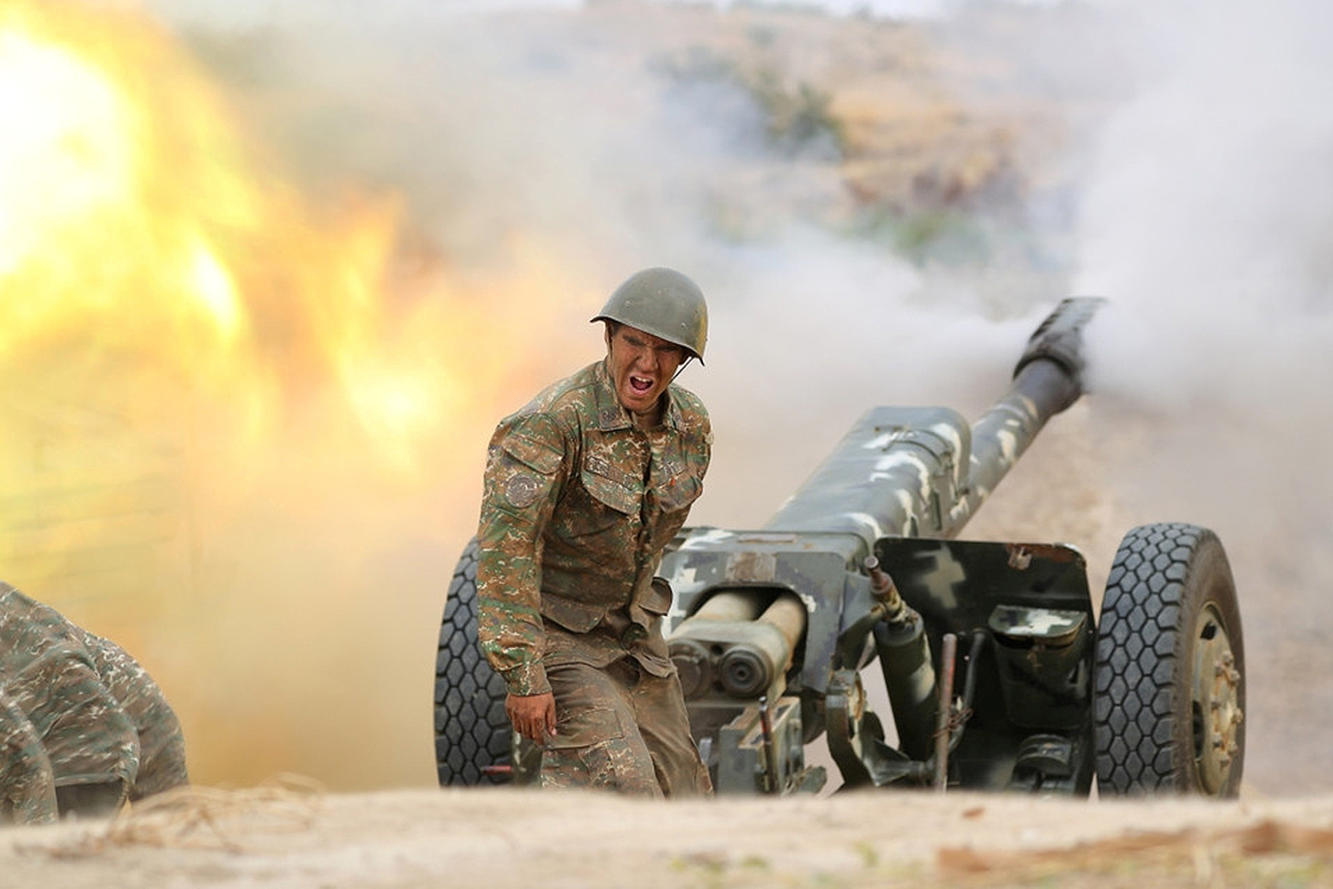 An ethnic Armenian soldier fires an artillery piece during fighting with Azerbaijan's forces in the breakaway region of Nagorno-Karabakh on Sept. 29. Defence Ministry of Armenia/Handout via REUTERS