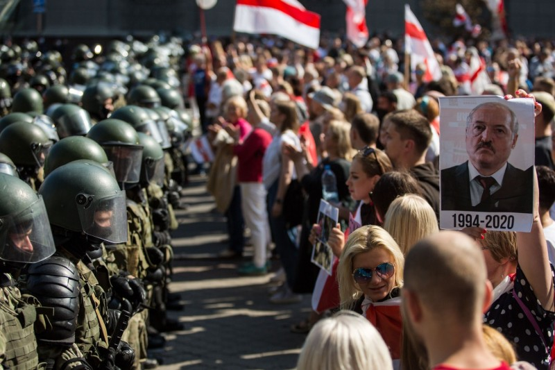 Belarusian servicemen block a street during an opposition rally against the disputed presidential election results in Minsk on Aug. 30, 2020.
