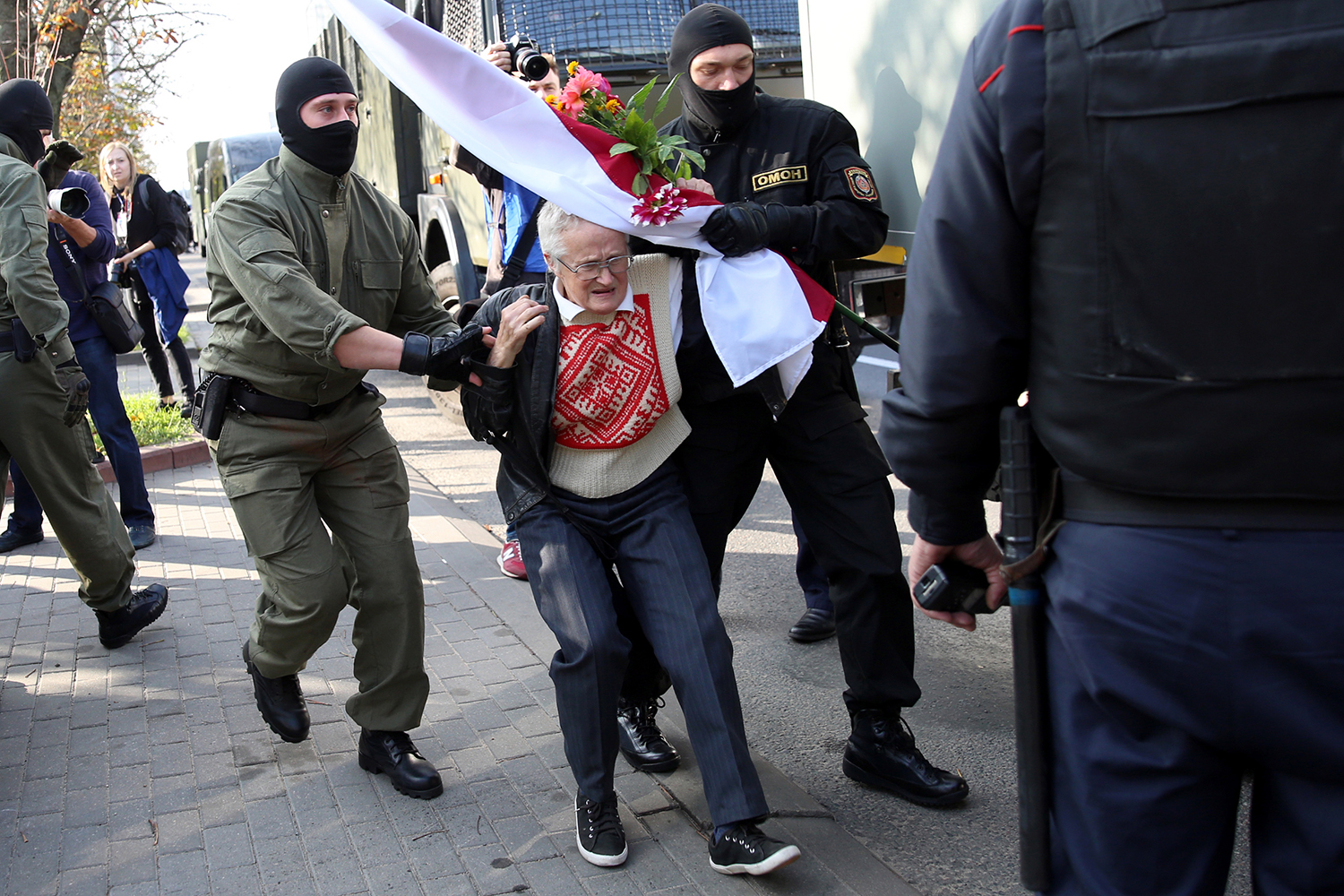 Law enforcement officers arrest and detain opposition activist Nina Baginskaya, 73, during a rally to protest against the presidential election results in Minsk, Belarus, on Sept. 19. TUT.BY/AFP via Getty Images