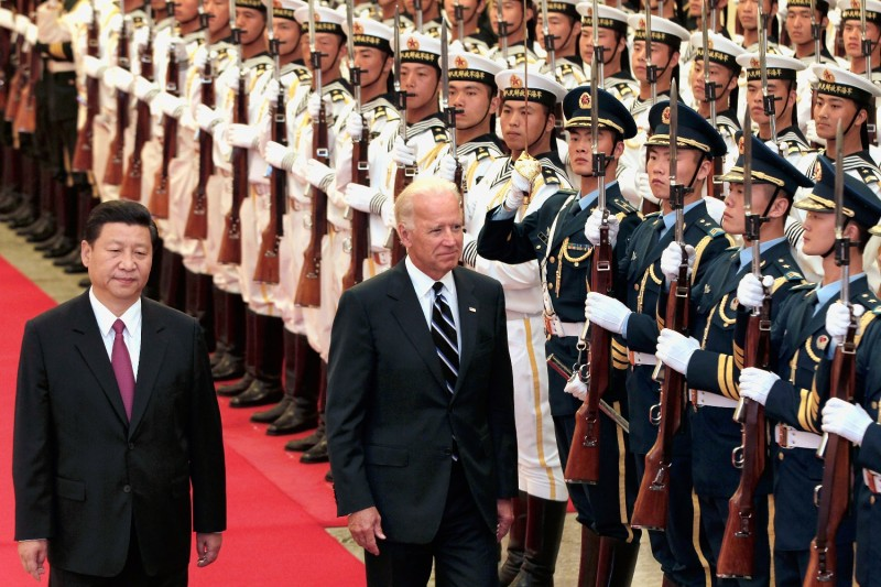 Then-Chinese Vice President Xi Jinping accompanies U.S. Vice President Joe Biden during a welcome ceremony inside the Great Hall of the People on Aug. 18, 2011 in Beijing.