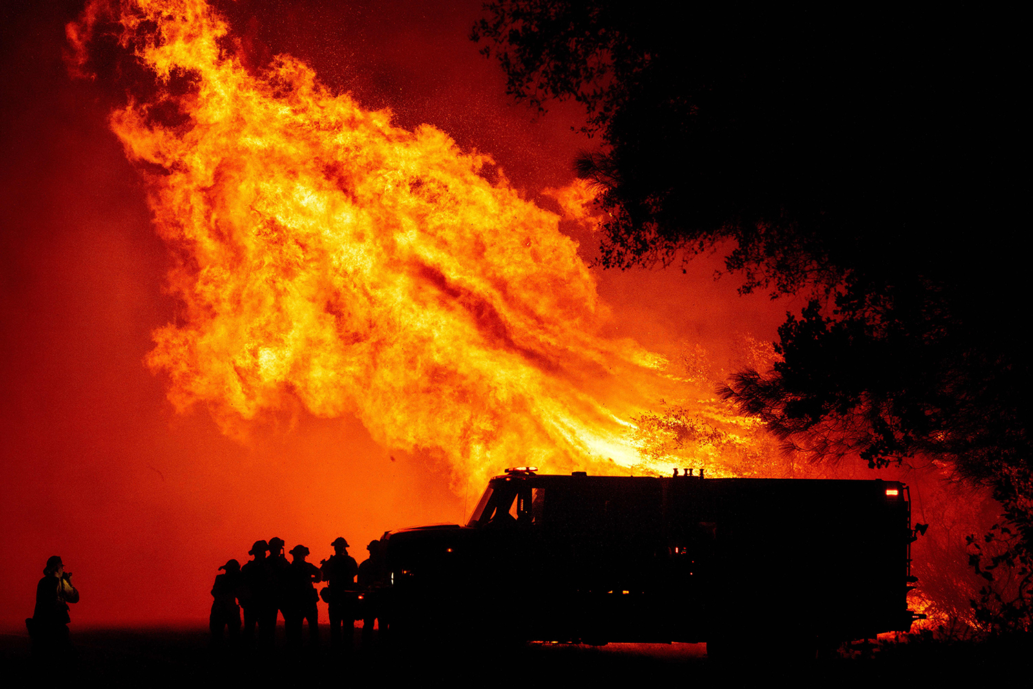 Butte County firefighters watch as flames tower over their truck during the Bear Fire in Oroville, California, on Sept. 9. JOSH EDELSON/AFP via Getty Images