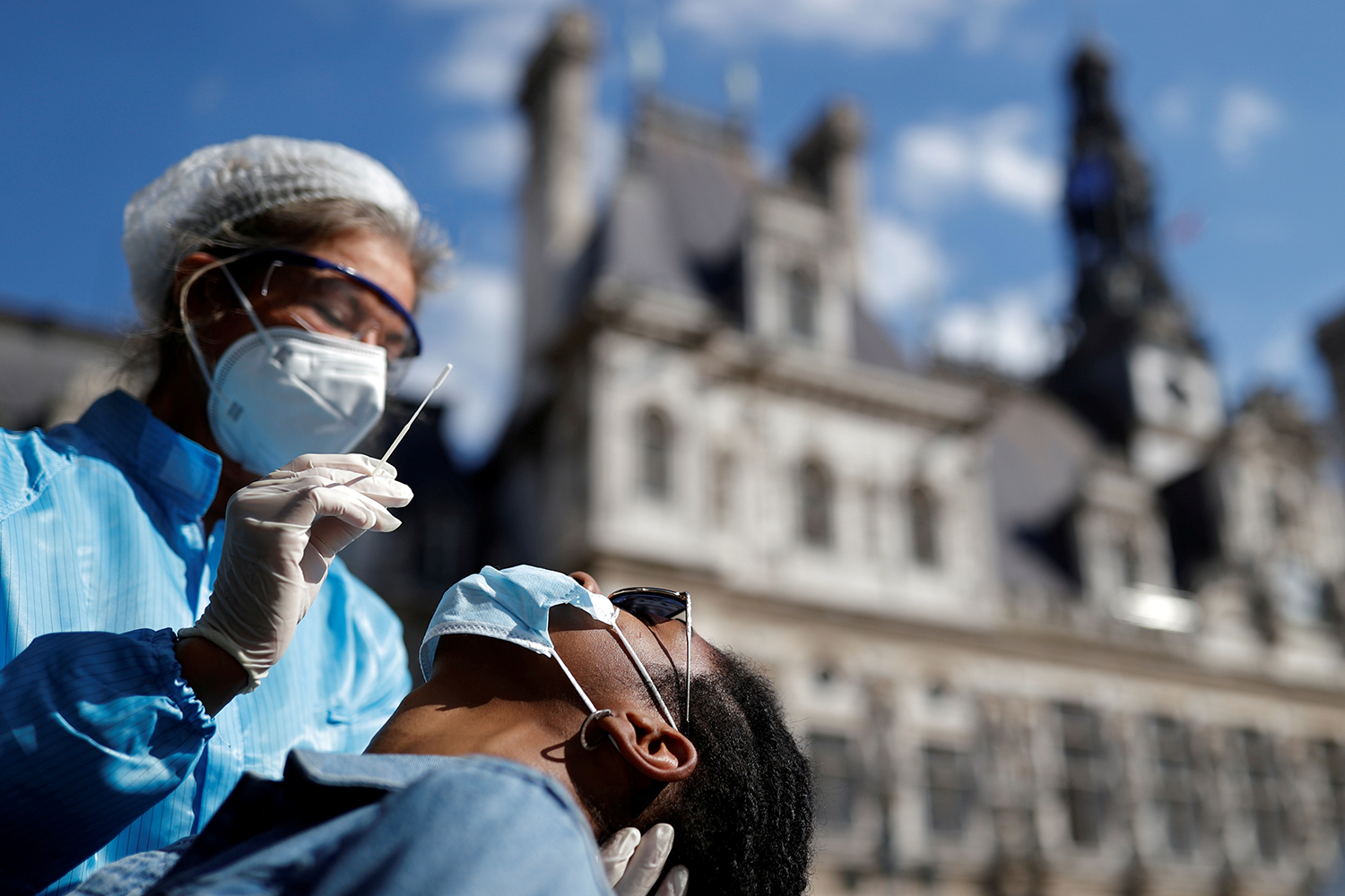 A health worker prepares to administer a nasal swab to a patient at a testing site for the coronavirus in front of the city hall in Paris on Sept. 2. Christian Hartmann/REUTERS