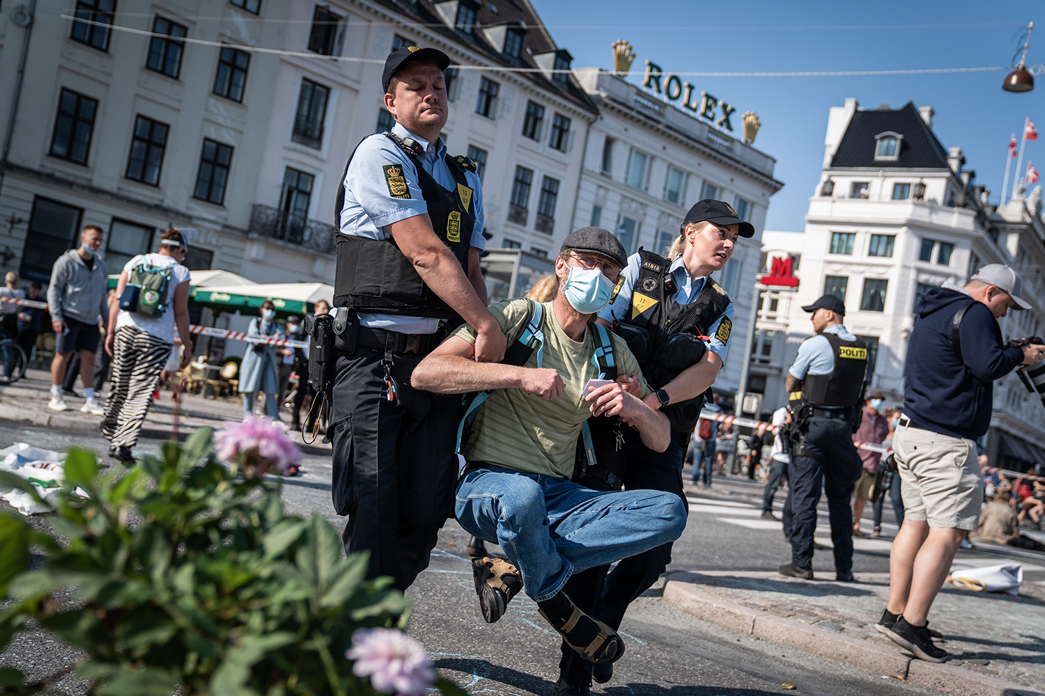 Activists from the Extinction Rebellion group are carried away by police as they block traffic at Kongens Nytorv Square in Copenhagen on Sept. 16. EMIL HELMS/Ritzau Scanpix/AFP via Getty Images