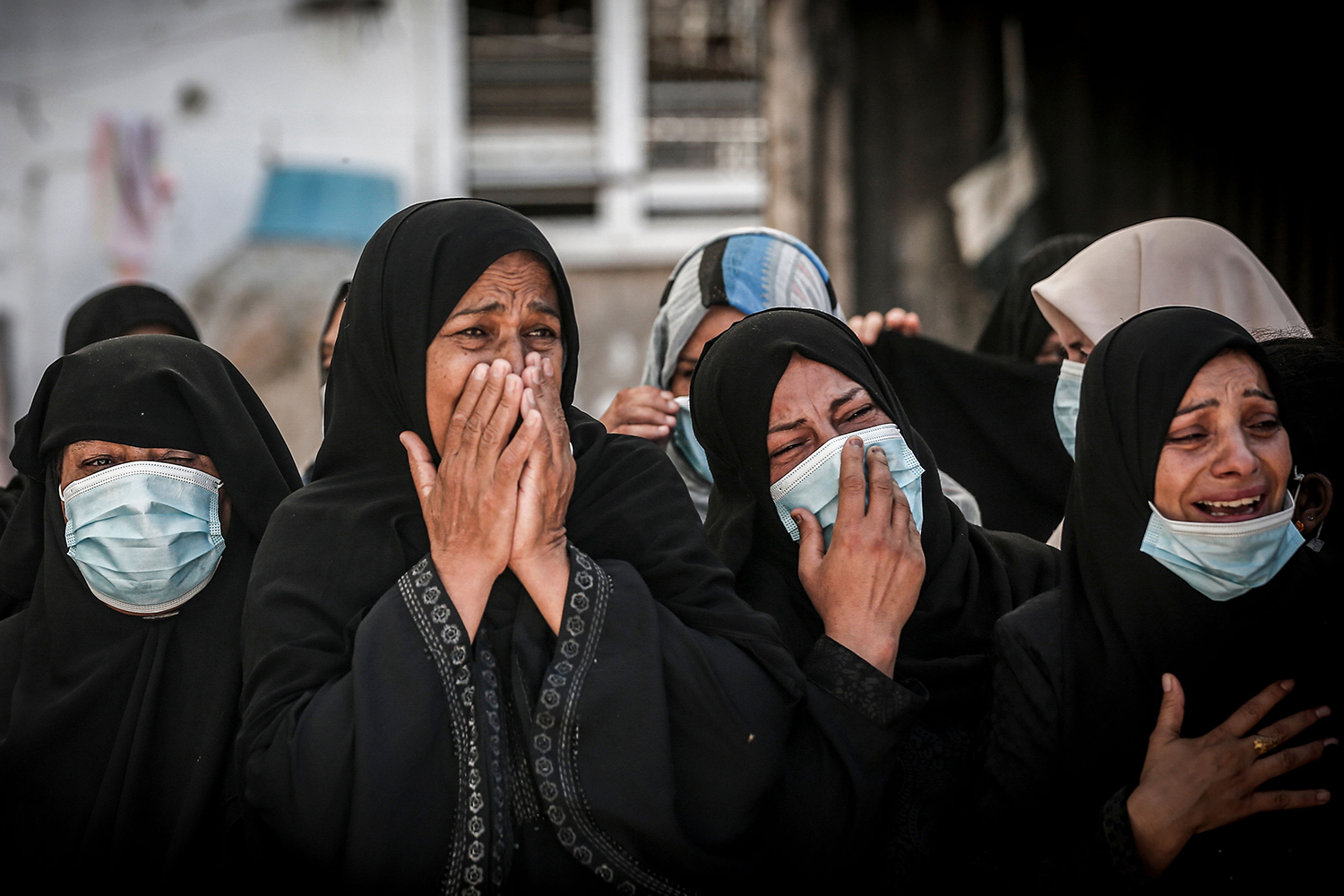 At a funeral in Deir al-Balah in the central Gaza Strip on Sept. 27, relatives mourn two Palestinian brothers who were shot at sea while fishing to the south of the Gaza Strip bordering Egypt. MAHMUD HAMS/AFP via Getty Images