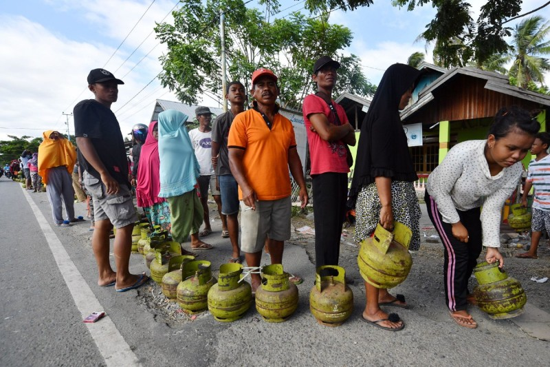 Residents line up for cooking gas in Palu, Indonesia, on Oct. 9, 2018, following the earthquake and tsunami that hit the area the month before.