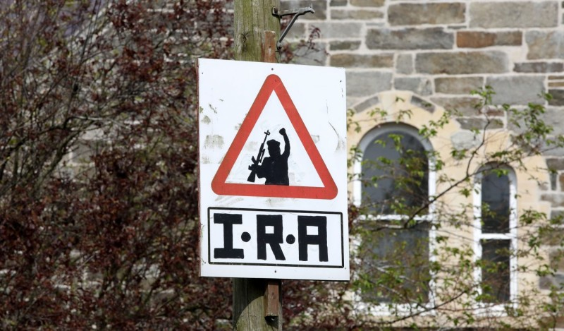 A picture shows an Irish Republican Army (IRA) sniper warning sign overlooking the Bogside area of Derry in Northern Ireland on April 20, 2019.