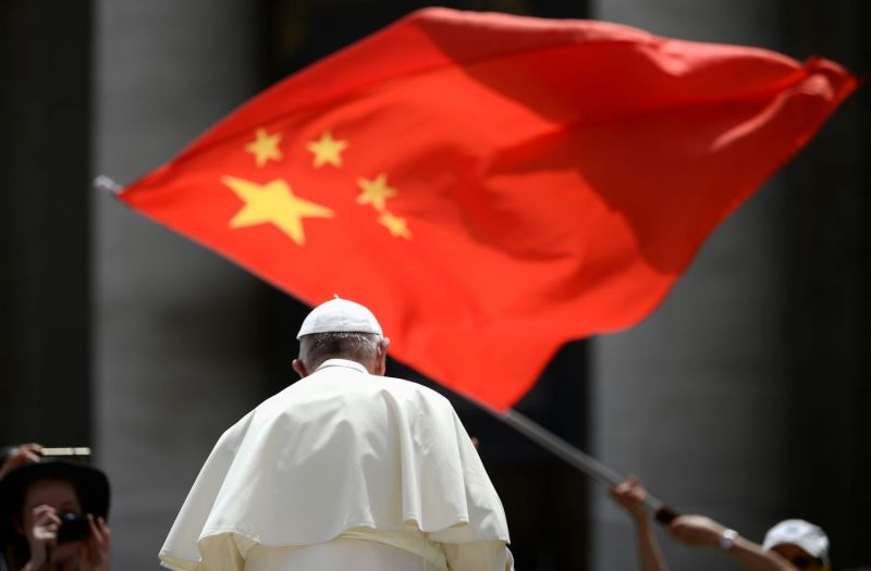 A worshipper waves the flag of China as Pope Francis leaves following the weekly general audience at St. Peter's Square in the Vatican on June 12, 2019.