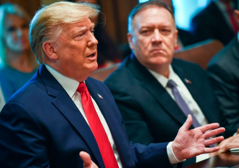 President Donald Trump speaks alongside Secretary of State Mike Pompeo.