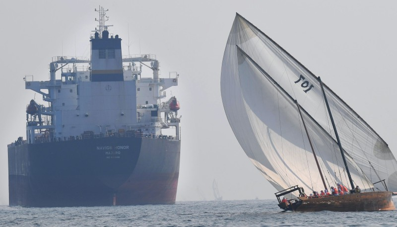 A dhow sails past a crude oil tanker near the Emirati capital Abu Dhabi, on Oct. 22, 2019.