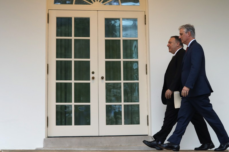 U.S. Secretary of State Mike Pompeo and National Security Advisor Robert O'Brien walk through the West Wing colonnade at the White House prior to an Oval Office meeting between President Donald Trump and Guatemalan President Jimmy Morales Dec. 17, 2019 in Washington, DC.