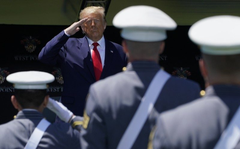 U.S. President Donald Trump salutes graduating West Point cadets.