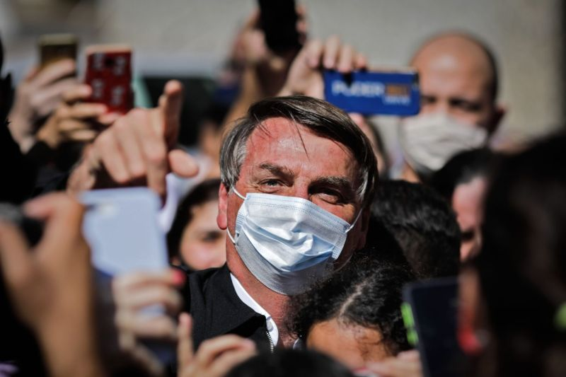 Brazilian President Jair Bolsonaro is surrounded by supporters while visiting  Brasilia on Aug. 23, 2020.