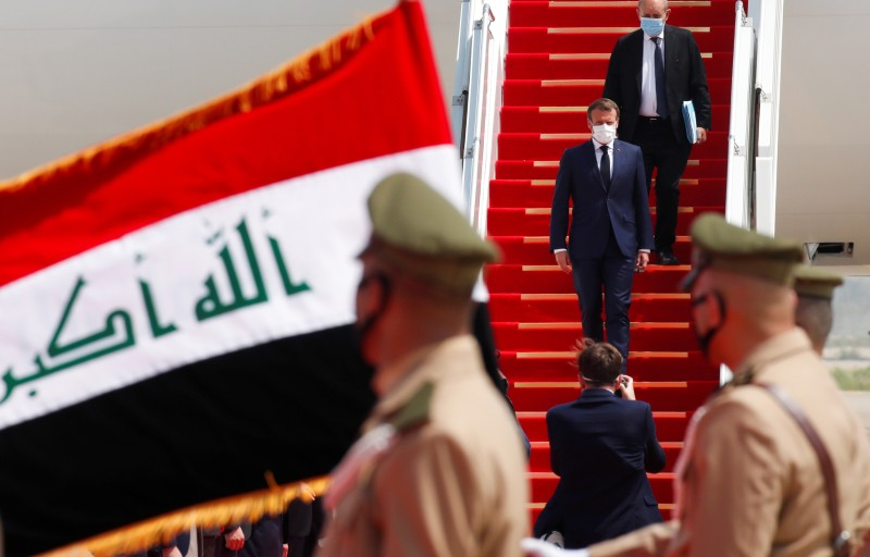 French President Emmanuel Macron gets off a plane as he arrives at Baghdad airport, on Sept. 2, 2020.