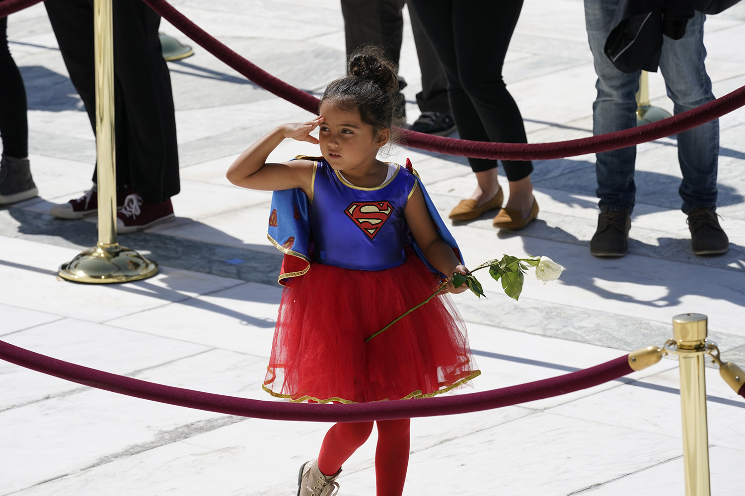 A girl dressed in a Supergirl costume pays her respects at the casket of Justice Ruth Bader Ginsburg on the steps of the U.S. Supreme Court in Washington on Sept. 23. Alex Brandon-Pool/Getty Images