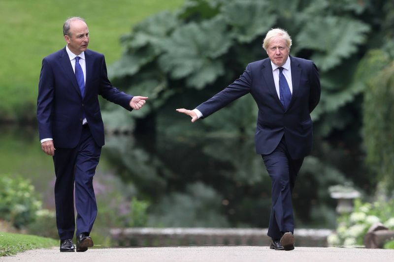 U.K. Prime Minister Boris Johnson and Irish Taoiseach Micheal Martin walk in the gardens at Hillsborough Castle during Johnson's visit to Belfast on Aug. 13.