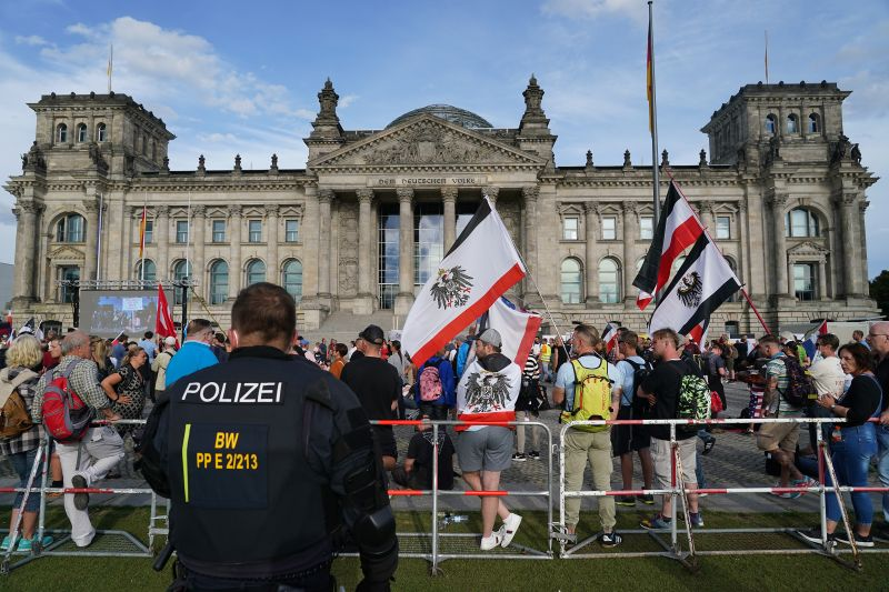 Riot police observe far-right protesters gathered outside the Reichstag during protests against coronavirus-related restrictions and government policy on Aug. 29 in Berlin.