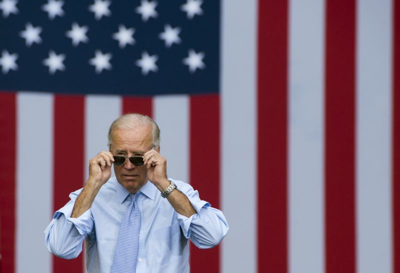 Joe Biden takes his sunglasses off as he arrives for a campaign event with President Barack Obama at Strawbery Banke Field in Portsmouth, New Hampshire, on Sept. 7, 2012.