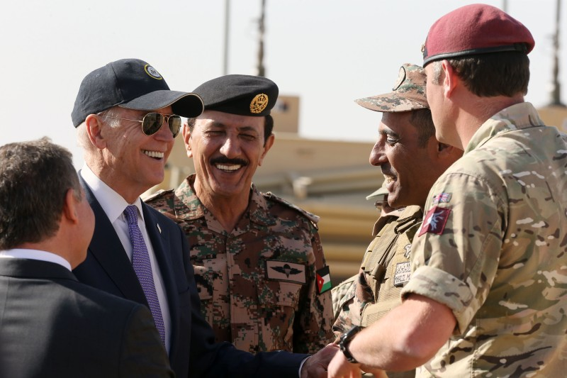U.S Vice President Joe Biden meets with troops during a visit with Jordan's King Abdullah at a joint Jordanian-American training center on March 10, 2016 in Zarqa northeast of Amman, Jordan.