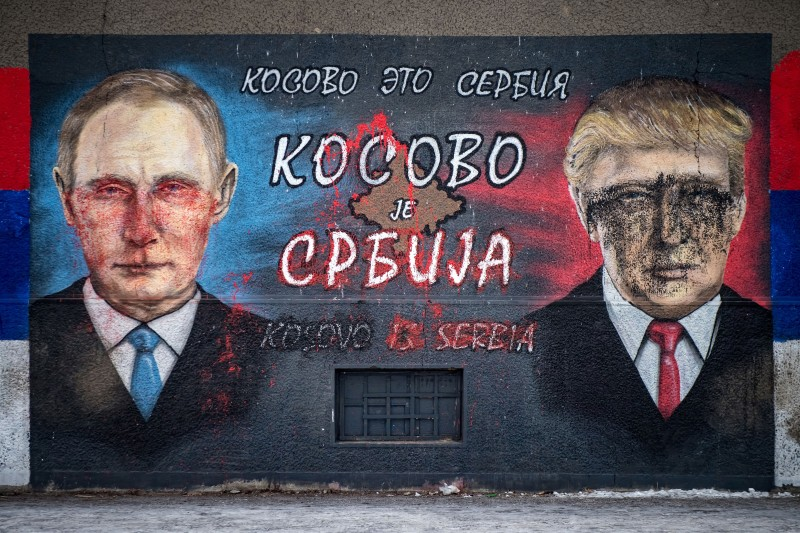 "A picture taken on Jan. 25, 2017 shows a mural, vandalized with paint, depicting Russian President Vladimir Putin and U.S. President Donald Trump and bearing the Cyrillic letters reading ""Kosovo is Serbia,"" in Belgrade."