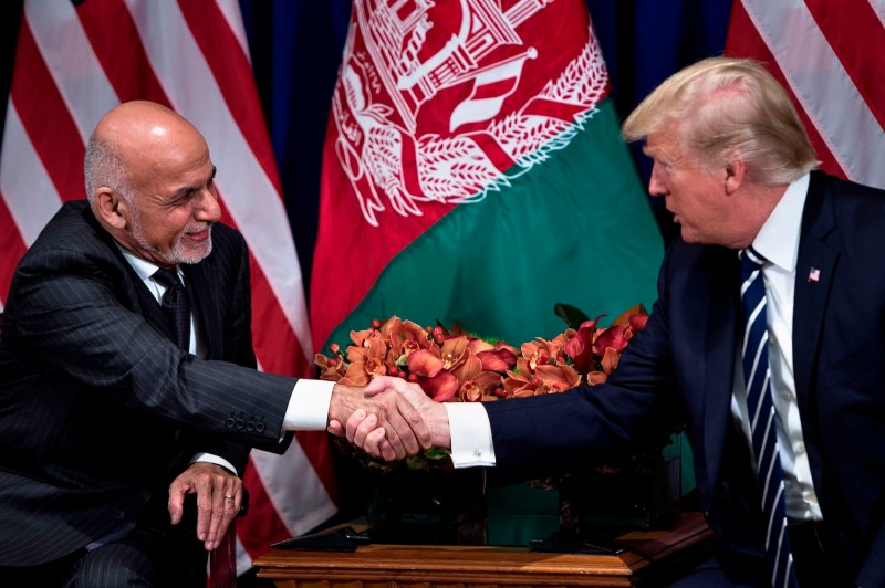 Afghanistan's President Ashraf Ghani and US President Donald Trump shake hands before a meeting at the Palace Hotel during the 72nd United Nations General Assembly on September 21, 2017 in New York City.
