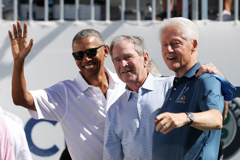 Former U.S. Presidents Barack Obama, George W. Bush and Bill Clinton attend the trophy presentation prior to Thursday foursome matches of the Presidents Cup at Liberty National Golf Club on September 28, 2017 in Jersey City, New Jersey.