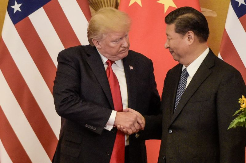U.S. President Donald Trump shakes hands with Chinese President Xi Jinping