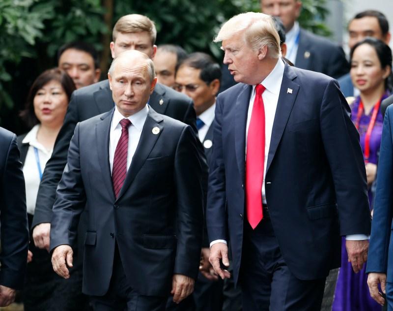 U.S. President Donald Trump and Russian President Vladimir Putin speak at a diplomatic summit.