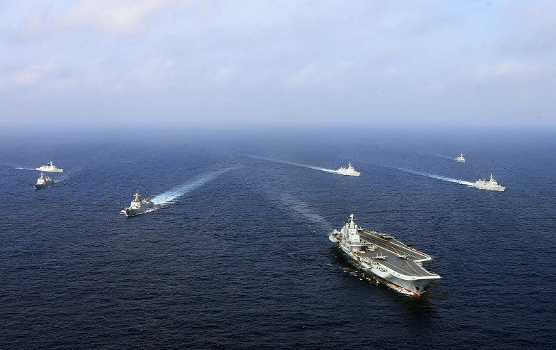 The Chinese aircraft carrier Liaoning and other ships sail during a naval drill in the East China Sea in April 2018.