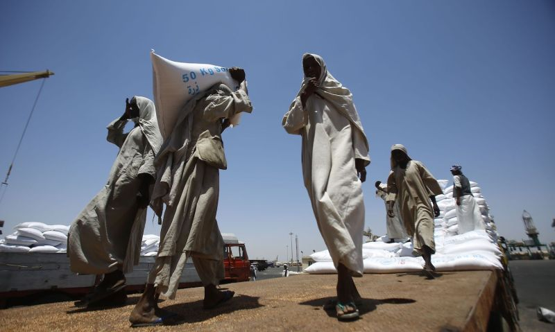 Dockers unload U.S. humanitarian aid in Sudan