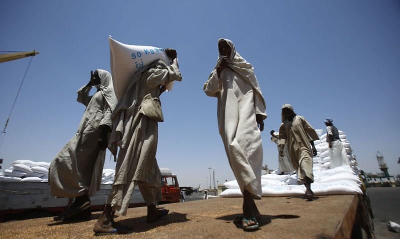 Dockers unload U.S. humanitarian aid in Sudan