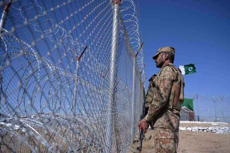 A Pakistani soldier stands next to a border fence along Afghanistan Paktika province in Angoor Adda, Pakistan on Oct. 18, 2017.