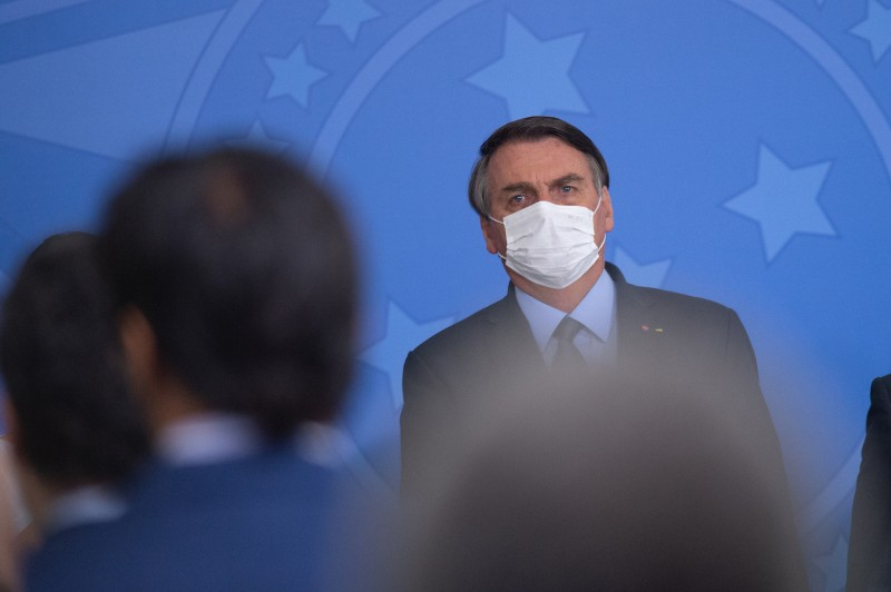 Jair Bolsonaro looks on at a ceremony in which Eduardo Pazuello takes office as Minister of Health amidst the coronavirus (COVID-19) pandemic in Brasilia on Sept. 16.