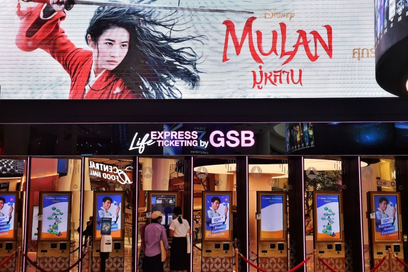 People buy tickets for Disney's Mulan at a cinema inside a shopping mall in Bangkok on Sept. 8.