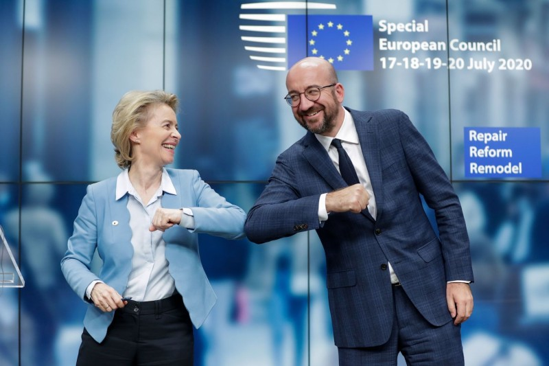 European Commission President Ursula von der Leyen and European Council President Charles Michel bump elbows at the end of a news conference in Brussels on July 21.