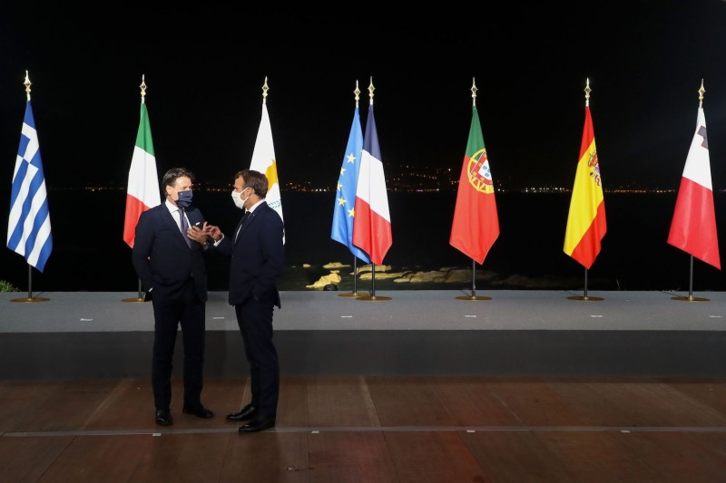 Italian Prime Minister Giuseppe Conte and French President Emmanuel Macron speak after the closing press conference of the seventh Med7 Mediterranean countries summit in Corsica on Sept. 10.