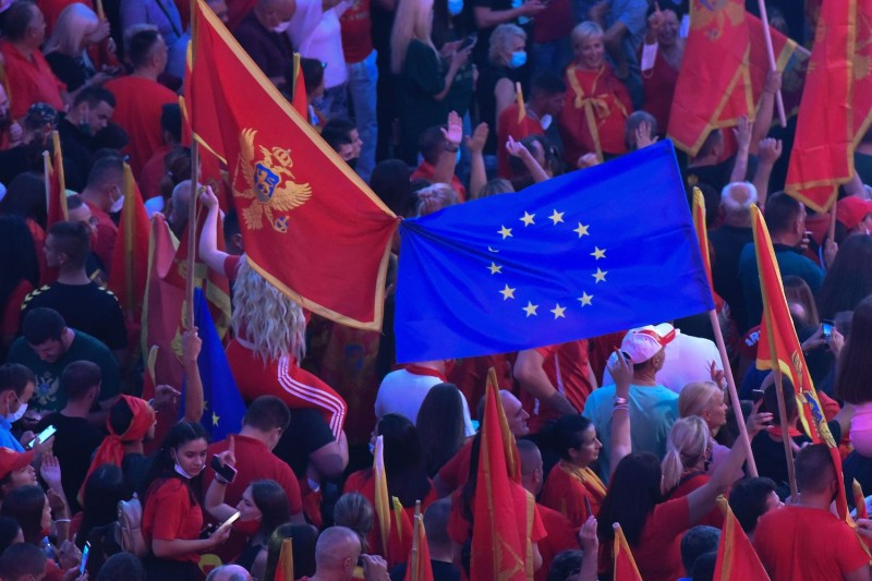People wave national and European flags during a post-election rally in Podgorica, Montenegro, on Sept. 6