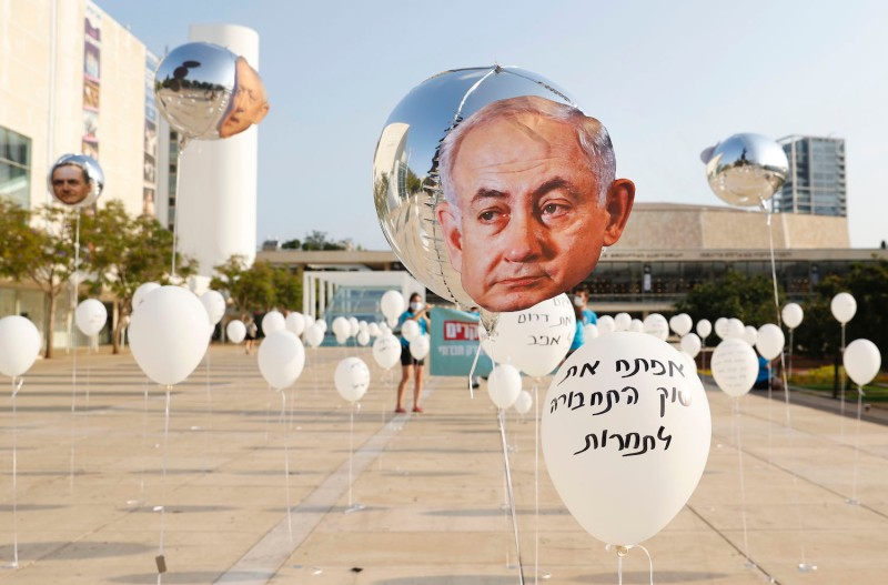 An art installation including a balloon with Prime Minister Benjamin Netanyahu's image on it is seen in Habima Square in Tel Aviv, Israel, on Sept. 15.