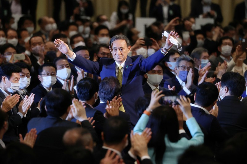 Japan's chief cabinet secretary, Yoshihide Suga, reacts after he was elected as the new head of the Liberal Democratic Party in Tokyo on Sept. 14.