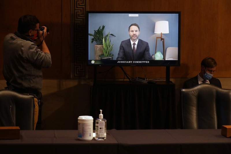 Donald Harrison, Google's president for global partnerships and corporate development, testifies via live video feed before a Senate Judiciary subcommittee during a hearing on anti-competitive online advertising in Washington on Sept. 15.