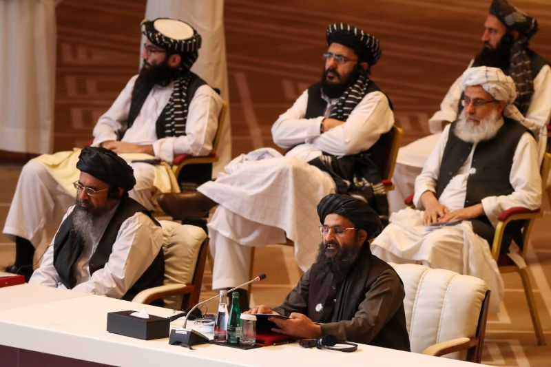 Taliban co-founder Mullah Abdul Ghani Baradar speaks during the opening session of peace talks between the Afghan government and the Taliban in Doha on Sept. 12.