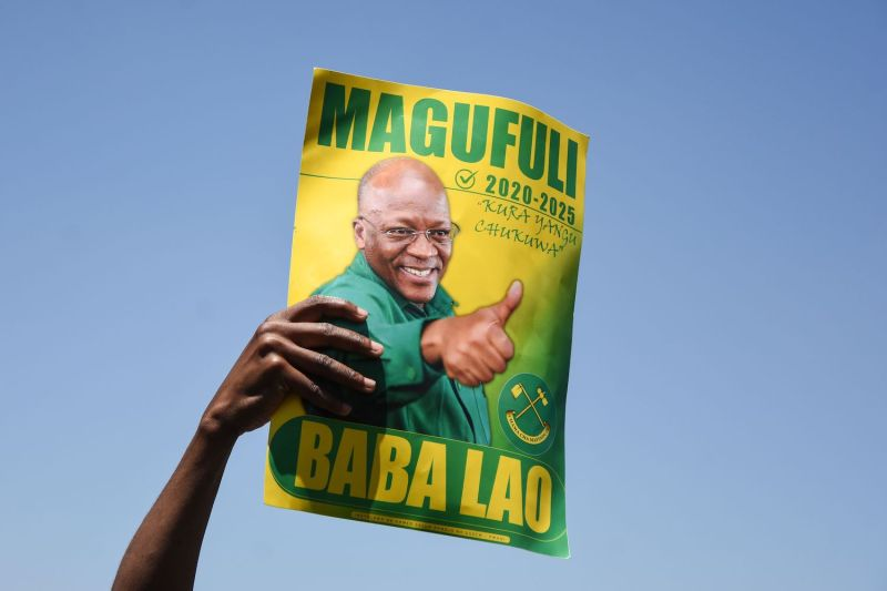 A supporter of Tanzania's ruling party holds a sign during the official launch of its official campaign for the October general election in Dodoma, Tanzania, on Aug. 29.